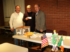 The Ancient Order of Hibernians Division 3 makes a donation to Angela's House