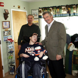 Former New York Islander and Hockey Hall of Famer Clark Gilles is seen with Eric and his dad  on a recent visit to Angela's House