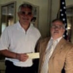 The Islip Kiwanis Club presented a check from a fundraiser dinner they held for Angela's House