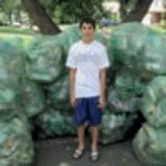 Vinny Pilicastro with his mountain of recycled containers he collected to help raise funds.
